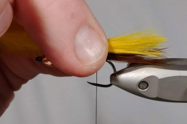 Measure the same length as the brown that is already tied down.